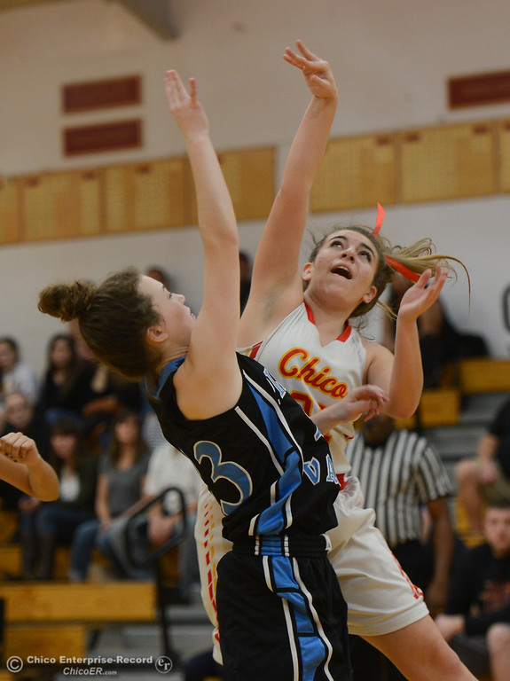 . Pleasant Valley\'s Shaley Vieg (23) tries to block Chico High\'s Kensey Kinney (21), Thursday, February 8, 2018, in Chico, California. (Carin Dorghalli -- Enterprise-Record)
