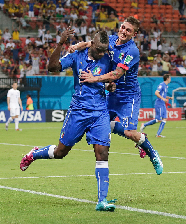 . Italy\'s Mario Balotelli (9) celebrates with Italy\'s Marco Verratti (23) after Balotelli scored his side\'s second goal during the group D World Cup soccer match between England and Italy at the Arena da Amazonia in Manaus, Brazil, Saturday, June 14, 2014.(AP Photo/Marcio Jose Sanchez)