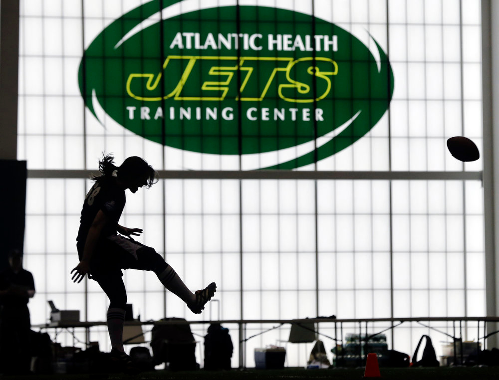 . Lauren Silberman boots the ball during kicker tryouts at an NFL football regional combine workout, Sunday, March 3, 2013, at the New York Jets\' training facility in Florham Park, N.J. (AP Photo/Mel Evans)