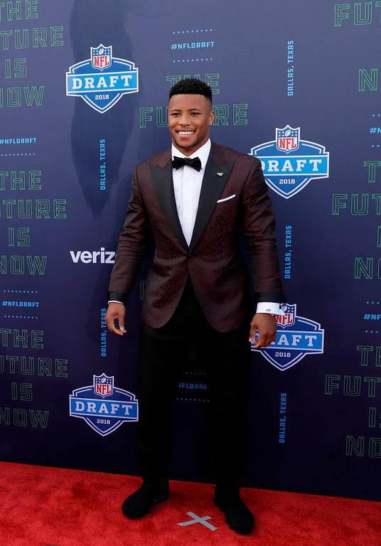 . Penn State\'s Saquon Barkley poses on the red carpet before the first round of the 2018 NFL football draft, Thursday, April 26, 2018, in Arlington, Texas. (AP Photo/Eric Gay)