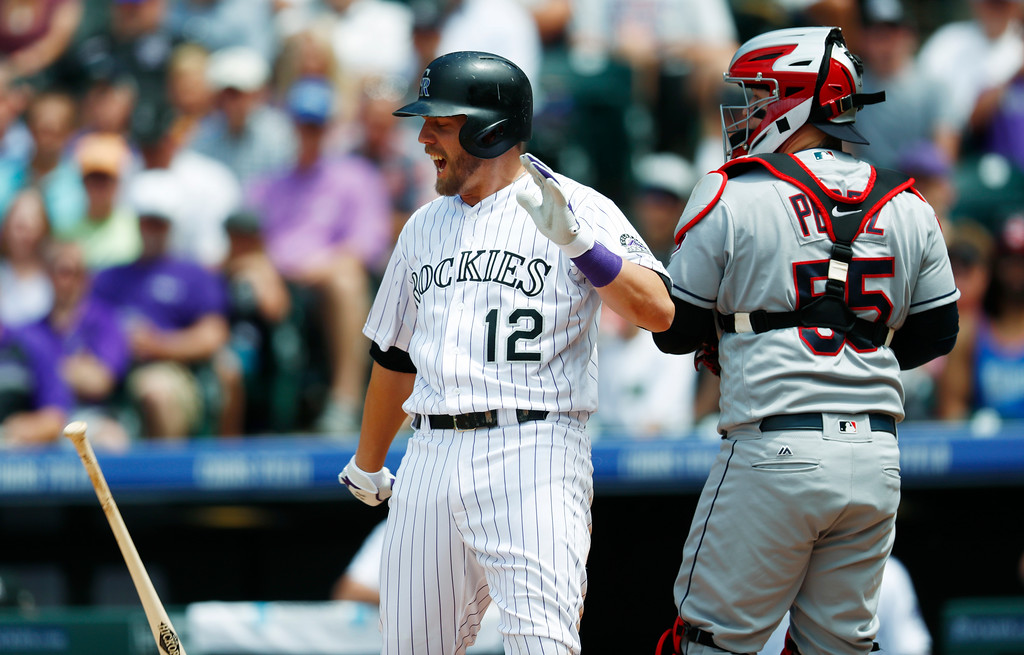 . Colorado Rockies\' Mark Reynolds, left, reacts after striking out with the bases loaded, next to Cleveland Indians catcher Roberto Perez, to end the third inning of a baseball game Wednesday, June 7, 2017, in Denver. Colorado won 8-1. (AP Photo/David Zalubowski)