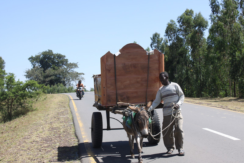 carrying bed on donkey cart
