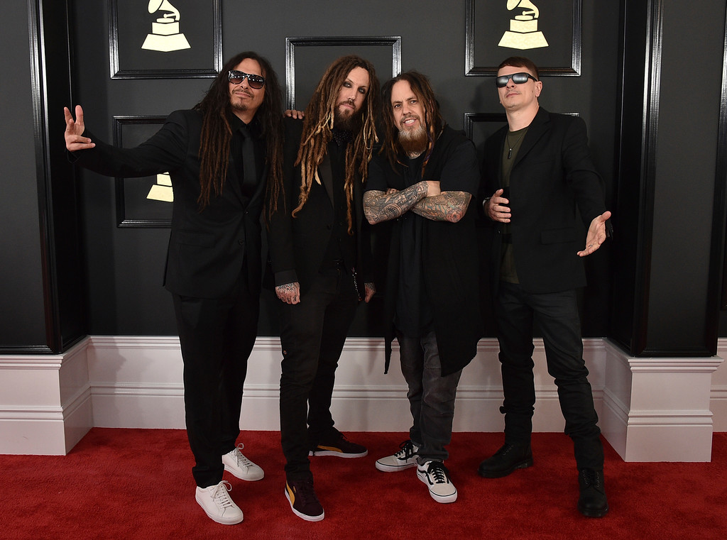 . James Shaffer, from left, Brian Welch, Reginald Arvizu and Ray Luzier of Korn arrive at the 59th annual Grammy Awards at the Staples Center on Sunday, Feb. 12, 2017, in Los Angeles. (Photo by Jordan Strauss/Invision/AP)