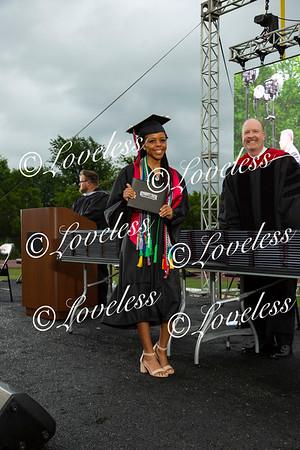 Graduation- class of 2020 Receiving Diplomas