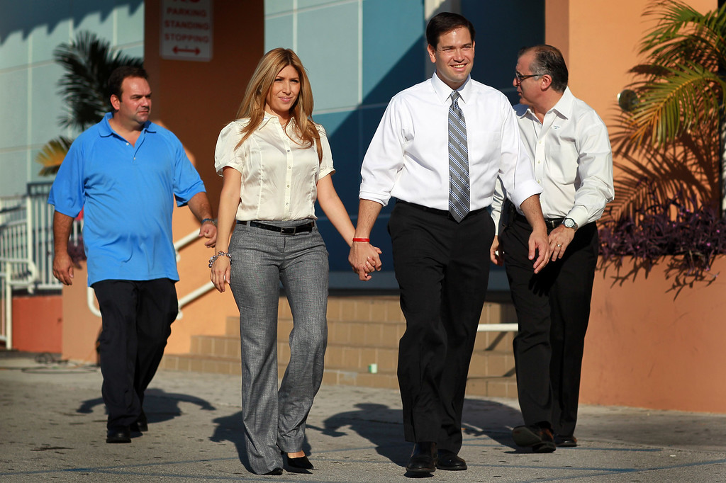 . Jeanette Rubio (2L), the wife of Republican Senate candidate Marco Rubio (2R), walks with him after voting at an early voting location on October 22, 2010 in Hialeah, Florida.  (Photo by Joe Raedle/Getty Images)
