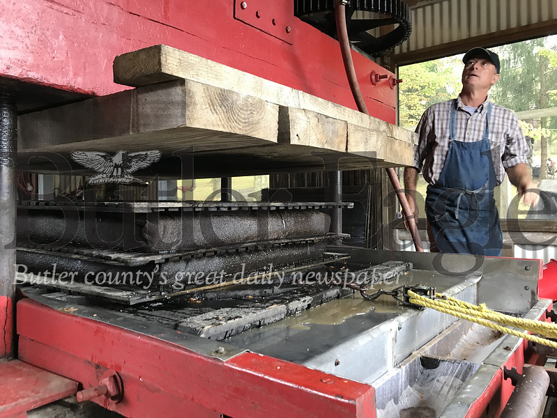 Attendees to the Portersville Fall Fling Steam Show on Sunday had a chance to see a steam powered cider press. The show is one of three held each year by the Northwest Pennsylvania Steam Engine and Old Equipment Association Inc. Photo by Gabriella Canales
