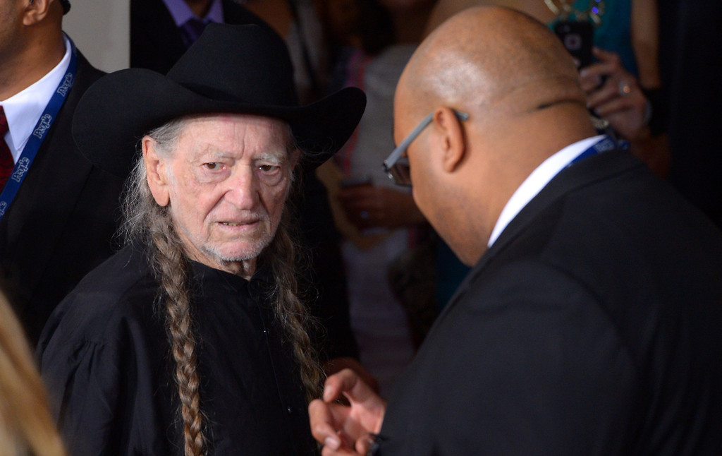 . Willie Nelson arrives at the 56th Annual GRAMMY Awards at Staples Center in Los Angeles, California on Sunday January 26, 2014 (Photo by David Crane / Los Angeles Daily News)