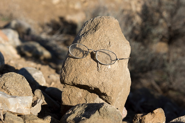 Glasses on a rock.