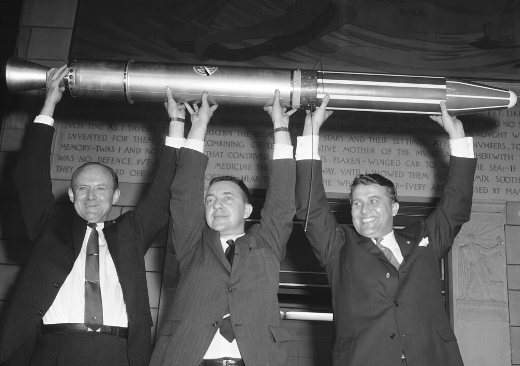 . Three top scientists who helped perfect the successful American satellite Explorer hold aloft a duplicate of the satellite at a new conference at the IGY headquarters in Washington, Jan. 31, 1958.  From left to right:  Dr. William H. Pickering of Cal Tech; Dr. James Van Allen of the University of Iowa; and Dr. Wernher von Braun, the Army\'s rocket expert who designed the Jupiter C missile which propelled the satellite.  (AP Photo/Bill Allen)