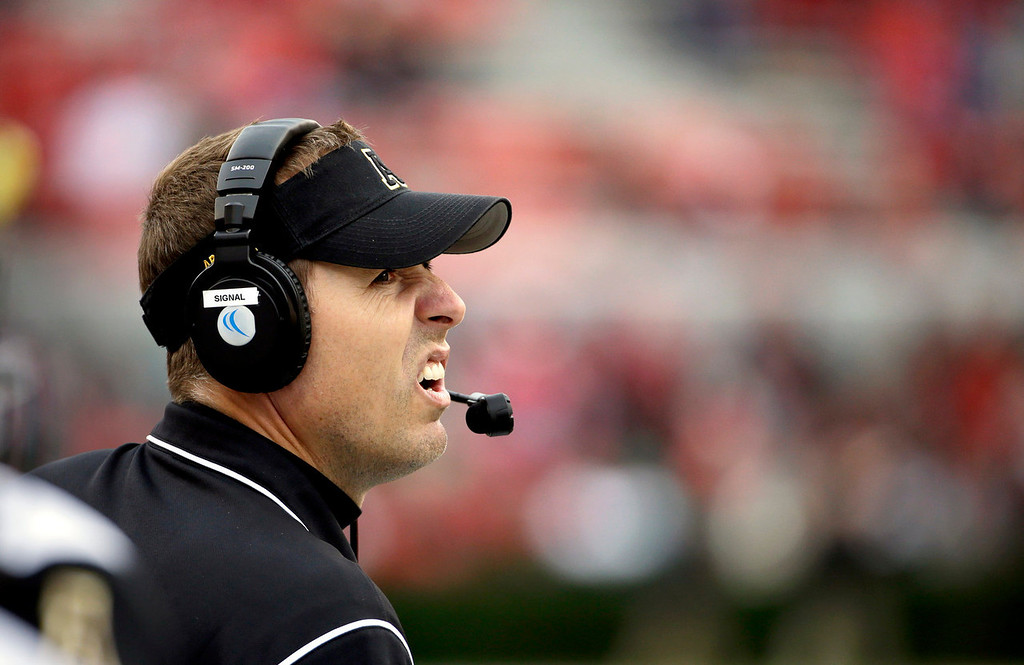 . Appalachian State head coach Scott Satterfield watches from the sidelines during the third quarter of an NCAA college football game against Georgia, Saturday, Nov. 9, 2013, in Athens, Ga. Georgia won 45-6. (AP Photo/David Goldman)