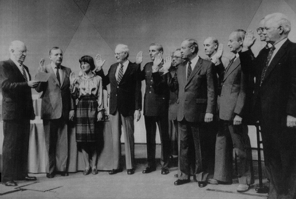 Description of . William Rogers, chairman of the Presidential Commission on the Space Shuttle Challenger Accident, left, swears in members of the commission on Feb. 6, 1986 at The National Academy of Sciences in Washington. From left are Rogers; Neil Armstrong; Dr. Sally Ride; Robert Rummel; Maj. Gen. Donald Kutyna; Dr. Arthur D.C. Walker Jr.; Joseph Suher; David Acheson; Richard Feynman; Dr. Albert Wheelon; and Robert Hotz.   Credit: AP Laserphoto