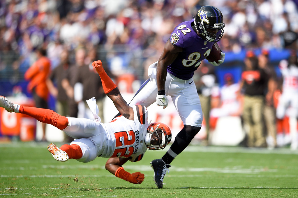 . Baltimore Ravens tight end Benjamin Watson (82) carries the ball past Cleveland Browns free safety Jabrill Peppers (22) during the first half of an NFL football game in Baltimore, Sunday, Sept. 17, 2017. (AP Photo/Nick Wass)