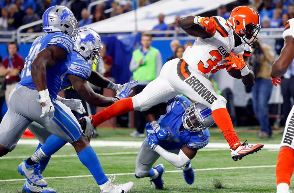 . Cleveland Browns running back Isaiah Crowell (34) leaps over Detroit Lions defensive back D.J. Hayden (31) for a 6-yard touchdown run during the second half of an NFL football game, Sunday, Nov. 12, 2017, in Detroit. (AP Photo/Paul Sancya)