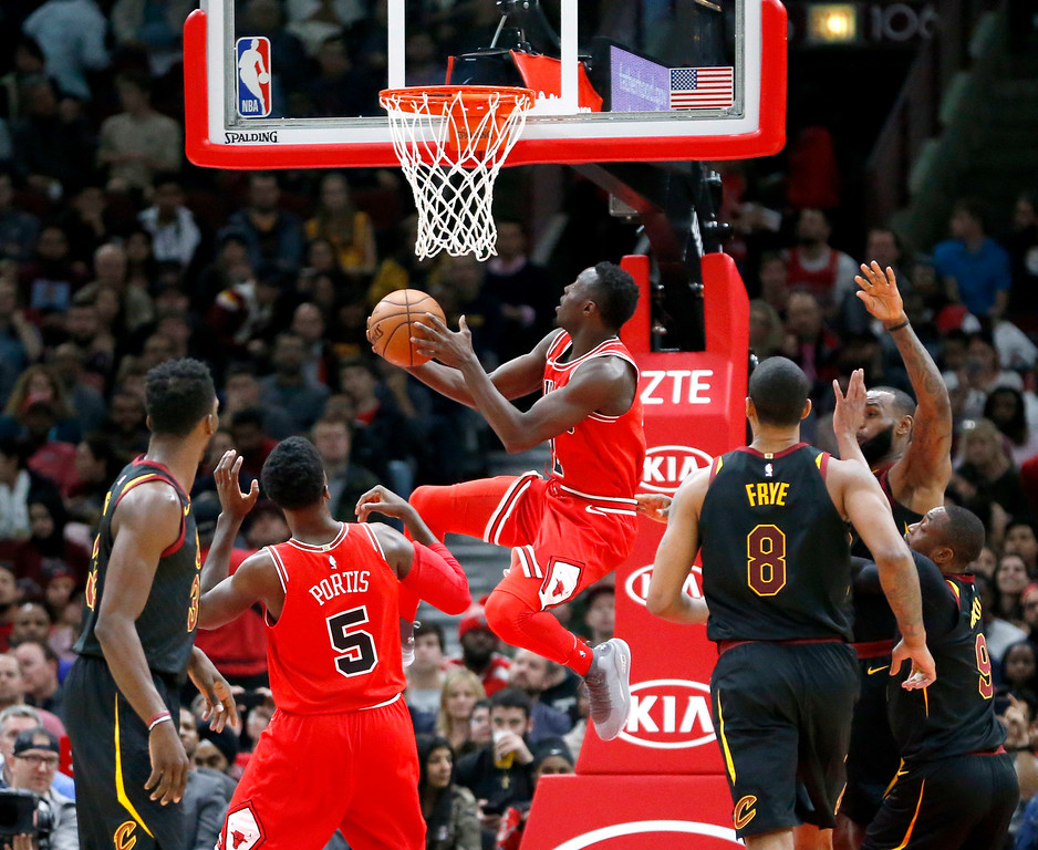 . Chicago Bulls\' Jerian Grant, center, scores on a reverse layup during the first half of an NBA basketball game against the Cleveland Cavaliers, Monday, Dec. 4, 2017, in Chicago. (AP Photo/Charles Rex Arbogast)