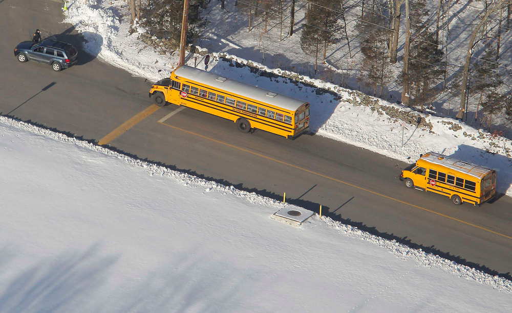 . School buses pull into the former Chalk Hill School, a disused school refurbished specifically for the students from Newtown which now bears the name Sandy Hook Elementary School, in Monroe, Connecticut January 3, 2013. Hundreds of children who had escaped a harrowing attack on their elementary school in Newtown, Connecticut, last month, headed back to classes Thursday for the first time since a gunman had barged into their school and killed 20 of their schoolmates and six staff members. REUTERS/Carlo Allegri
