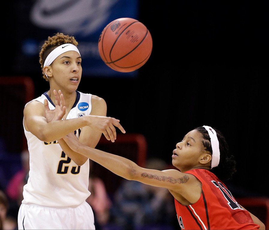 . California\'s Layshia Clarendon, left, passes in front of Georgia\'s Tiaria Griffin during the first half in a regional final in the NCAA women\'s college basketball tournament, Monday, April 1, 2013, in Spokane, Wash. (AP Photo/Elaine Thompson)
