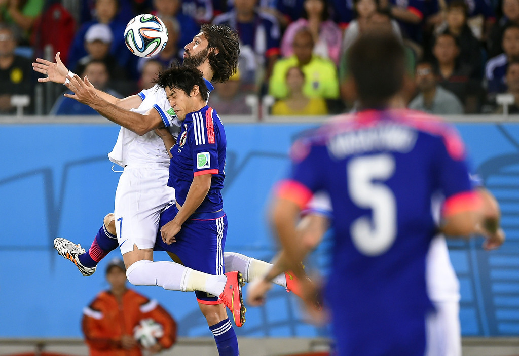 . Greece\'s forward Georgios Samaras (L) vies with Japan\'s defender Atsuto Uchida (R) during a Group C football match between Japan and Greece at the Dunas Arena in Natal during the 2014 FIFA World Cup on June 19, 2014.  FABRICE COFFRINI/AFP/Getty Images