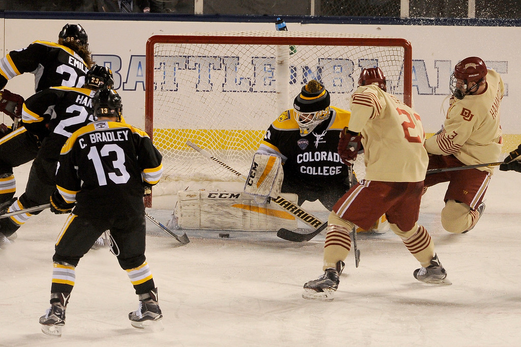 . Colorado College goalie Jacob Nehama (31) makes a pad save on a shot by the University of Denver during the third period at Coors Field in Denver, Colorado on February 20, 2016. (Photo by Seth McConnell/The Denver Post)
