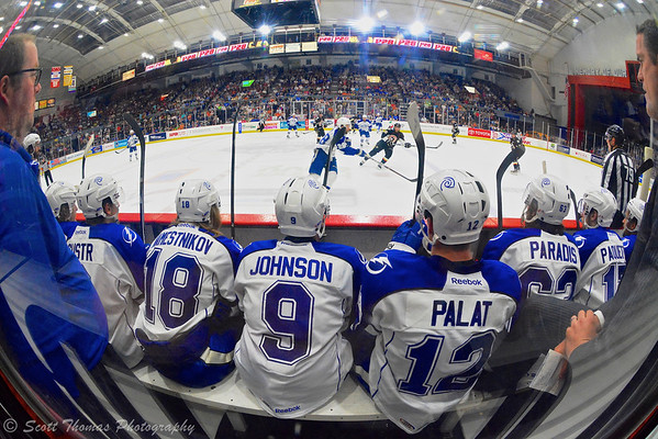 Syracuse Crunch players Andrej Sustr (2), Vladislav Namestnikov (18), Tyler Johnson (9), Ondrej Palat (12), Philippe Paradis (63) and Cedric Paquette (17) watch from the bench during a Crunch power play against  the Wilkes-Barre/Scranton Penguins in American Hockey League (AHL) Calder Cup Playoff action at the Onondaga County War Memorial on Saturday, June 1, 2013.