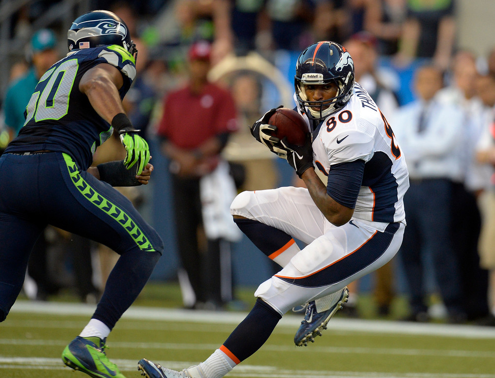 . SEATTLE, WA. - AUGUST 17: Denver Broncos tight end Julius Thomas (80) picks up a few yards after catching a pass in front of Seattle Seahawks defensive end O\'Brien Schofield (50) during the first quarter August 17, 2013 at Century Link Field. (Photo By John Leyba/The Denver Post)