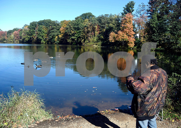 10/17/2017 Mike Orazzi | Staff Jose Torres while spending some time fishing at Birge Pond in Bristol Tuesday afternoon.