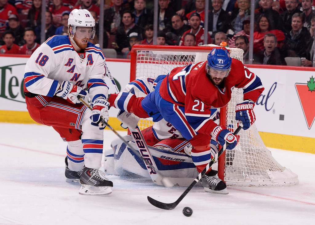 . Marc Staal #18 of the New York Rangers and Brian Gionta #21 of the Montreal Canadiens battle for the puck in front of the net  during Game Five of the Eastern Conference Final in the 2014 NHL Stanley Cup Playoffs at Bell Centre on May 27, 2014 in Montreal, Canada.  (Photo by Richard Wolowicz/Getty Images)
