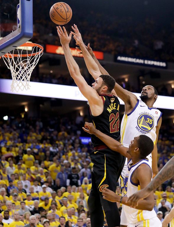 . Cleveland Cavaliers forward Larry Nance Jr. (22) shoots against Golden State Warriors forward Kevin Durant (35) during the second half of Game 1 of basketball\'s NBA Finals in Oakland, Calif., Thursday, May 31, 2018. (AP Photo/Marcio Jose Sanchez)