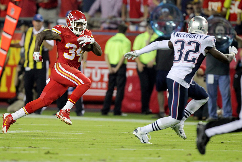 . Kansas City Chiefs running back Knile Davis, left, runs for a 48-yard gain as New England Patriots free safety Devin McCourty defends during the second quarter of an NFL football game Monday, Sept. 29, 2014, in Kansas City, Mo. (AP Photo/Ed Zurga)