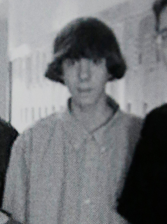 . This undated photo shows Adam Lanza posing for a group photo of the technology club which appeared in the Newtown High School yearbook. Authorities have identified Lanza as the gunman who killed his mother at their home and then opened fire Friday, Dec. 14, 2012, inside an elementary school in Newtown, Conn., killing 26 people, including 20 children, before killing himself.  Richard Novia, a one-time adviser to the technology club, verified that the photo shows Lanza. (AP Photo)