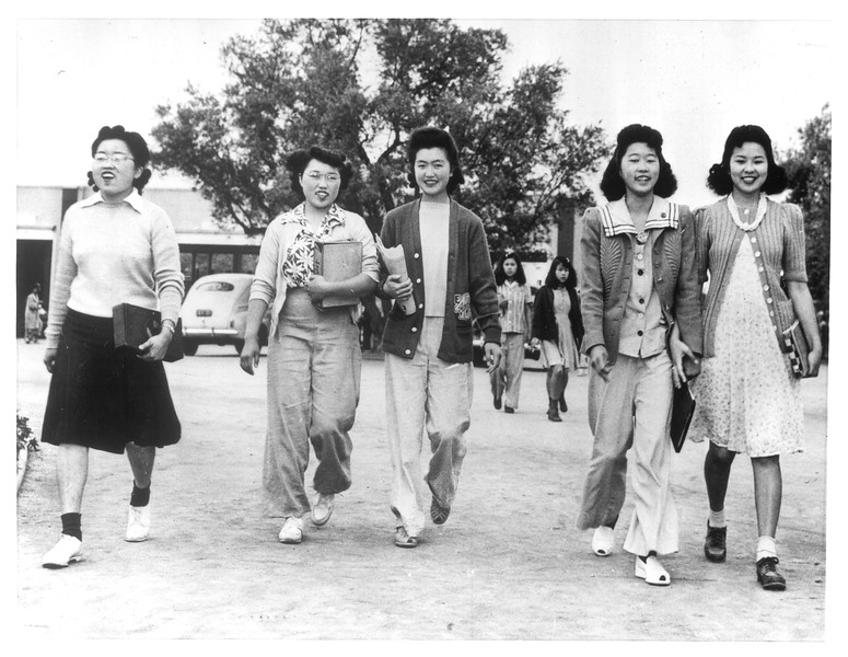 """""""Marching to School -- Japanese schoolgirls march along to school at Santa Anita Assembly Center.""""--caption on photograph"""