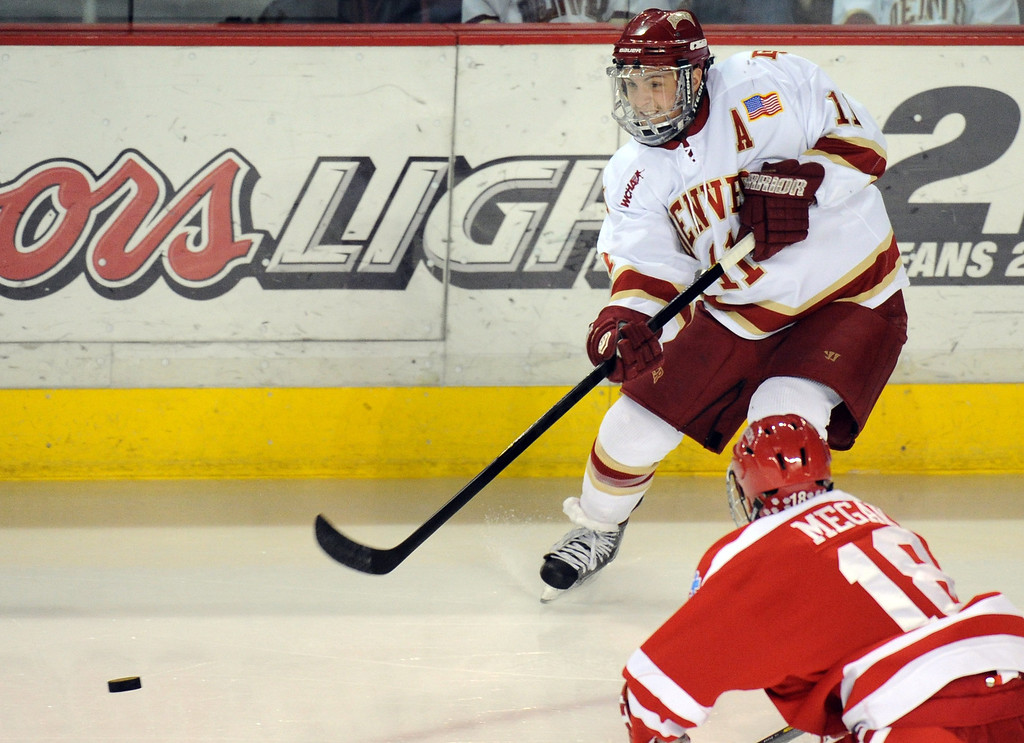 . University of Denver Chris Knowlton (11), top, controls the puck against Boston University Wade Megan (18) in the 1st period of the game  at Magness Arena on in Denver on Saturday, Dec. 29, 2012. Hyoung Chang, The Denver Post