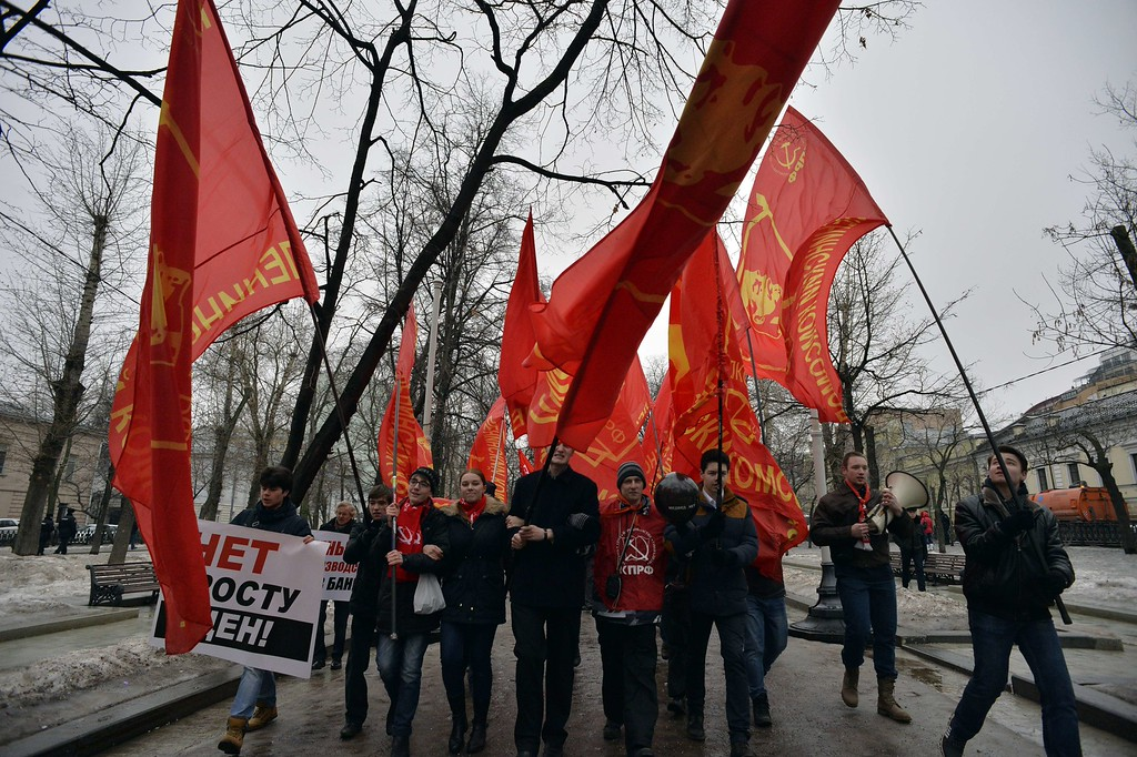 . Russian Communist party supporters carry red flags during a rally against the policies conducted by the Russian government in central Moscow on March 1, 2015. YURI KADOBNOV/AFP/Getty Images