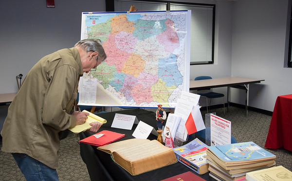10/18/19 Wesley Bunnell | StaffrrGene Yetter, a members of the Polish Genealogical Society, examines a directory of Polish villages before the start of the society's meeting at the CCSU ITBD on Friday night.