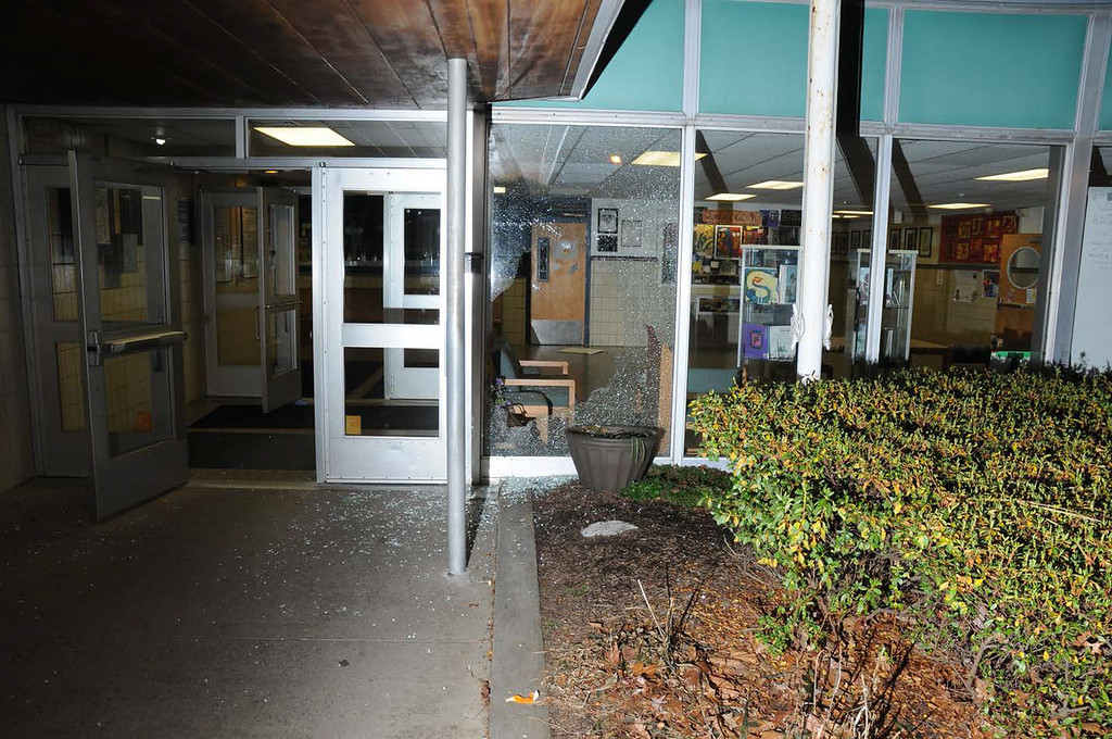 . In this handout crime scene evidence photo provided by the Connecticut State Police, shows damage done to the front entrance at Sandy Hook Elementary School following the December 14, 2012 shooting rampage, taken on an unspecified date in Newtown, Connecticut.   (Photo by Connecticut State Police via Getty Images)