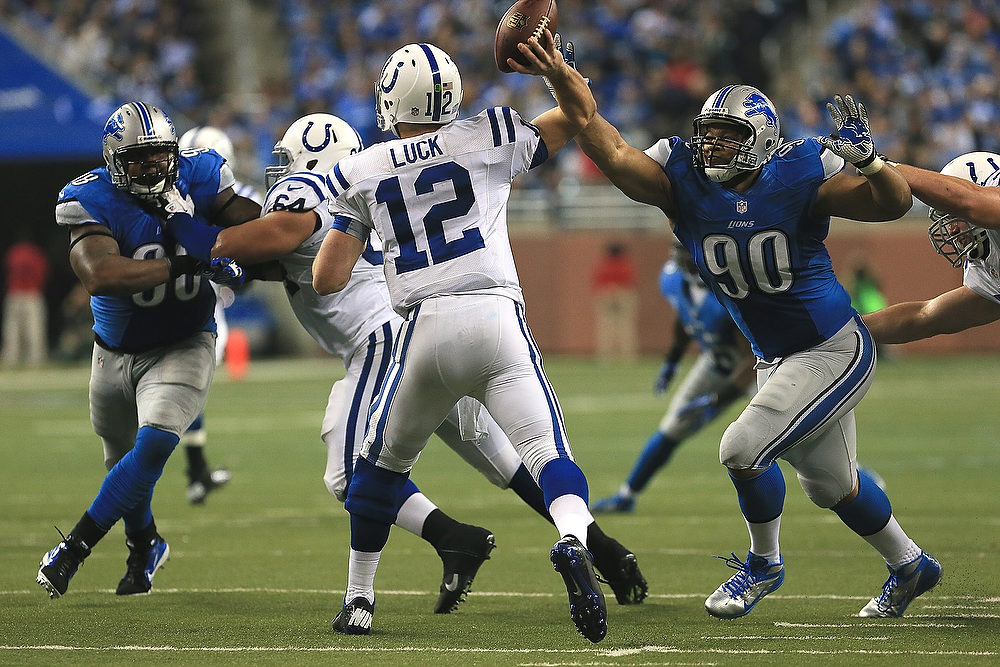 Description of . Andrew Luck #12 of the Indianapolis Colts gets pressure from Ndamukong Suh #90 and Nick Fairley #98 of the Detroit Lions at Ford Field on December 2, 2012 in Detroit, Michigan. The Colts won 35-33  (Photo by Dave Reginek/Getty Images)