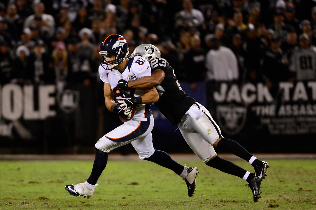 . Denver Broncos wide receiver Eric Decker #87 pulls in a pass in front of Oakland Raiders defensive back Joselio Hanson #23 at the O.co Coliseum, in Oakland , CA December 06, 2012.      Joe Amon, The Denver Post