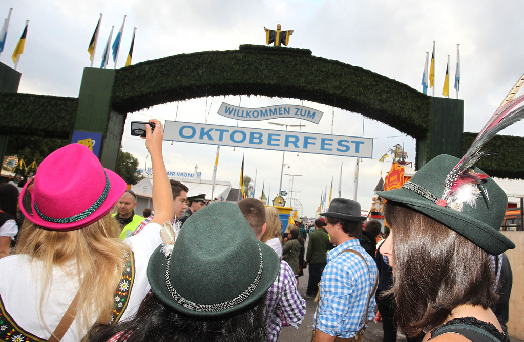 . Visitors stand at the main entrance to the Oktoberfest beer festival at the Theresienwiese in Munich, southern Germany, on September 21, 2013. The world\'s biggest beer festival Oktoberfest will run until October 6, 2013.  AFP PHOTO / DPA / KARL-JOSEF HILDENBRAND/AFP/Getty Images