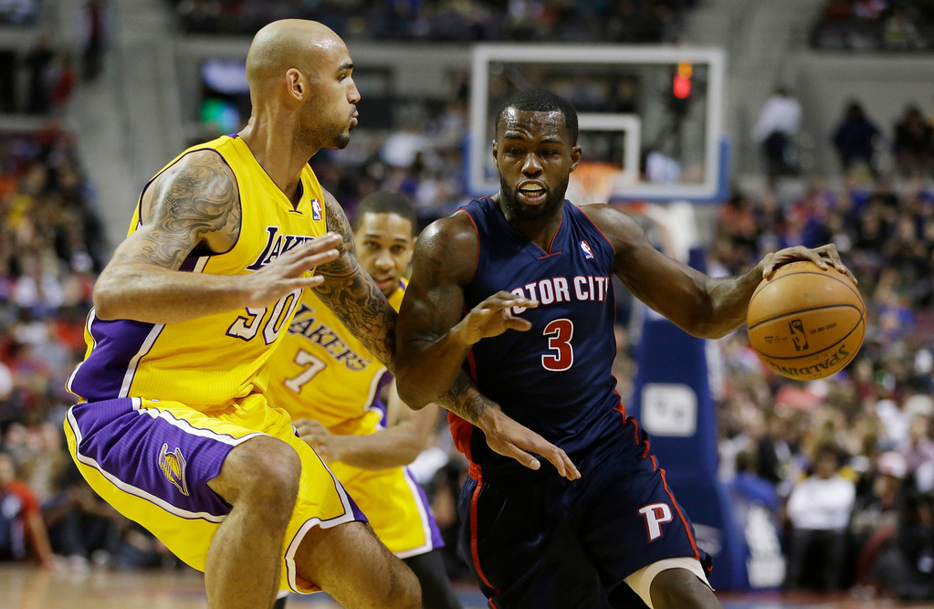 . Detroit Pistons guard Rodney Stuckey (3) drives around Los Angeles Lakers center Robert Sacre (50) during the second half of an NBA basketball game at the Palace in Auburn Hills, Mich., Friday, Nov. 29, 2013. (AP Photo/Carlos Osorio)
