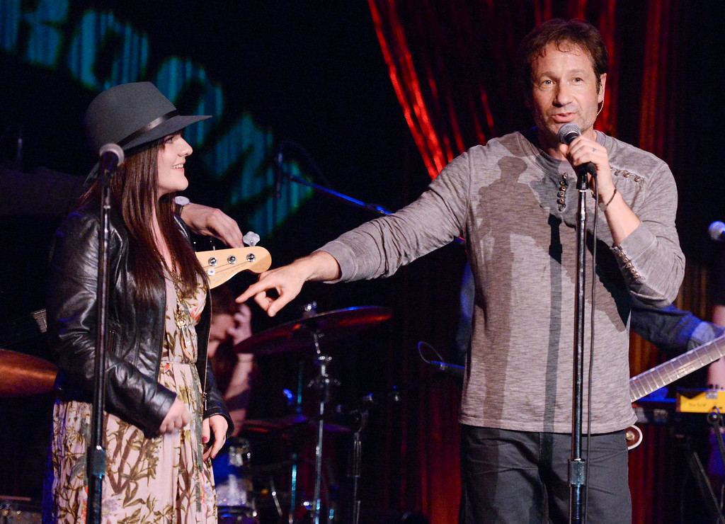 """. David Duchovny is joined by \""""Californication\"""" co-star Madeleine Martin during his performance at The Cutting Room, in support of the release of his debut album \""""Hell Or Highwater\"""", on Tuesday, May 12, 2015, in New York. (Photo by Evan Agostini/Invision/AP)"""
