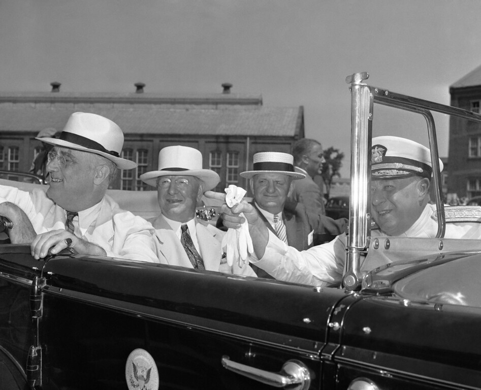 . Admiral M.H. Simons, right, commandant of the Norfolk, Va., Navy Yard, is pointing out new construction at the yard to, left to right, U.S. President Franklin D. Roosevelt, secretary of Navy Frank Knox, and Rep. Carl Vinson, (D-Ga.) of the house naval affairs committee during their inspection of defenses and defense work at the navy yard on July 29, 1940. (AP Photo)