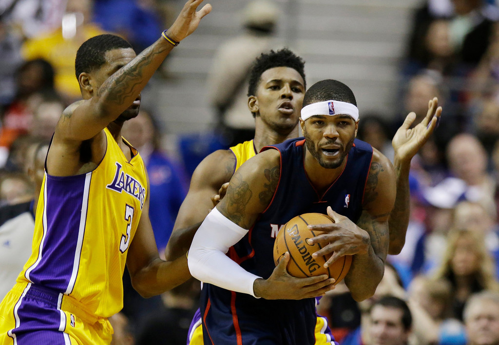 . Los Angeles Lakers forward Shawne Williams (3) and forward Nick Young defend Detroit Pistons forward Josh Smith, right, during the second quarter of an NBA basketball game at the Palace in Auburn Hills, Mich., Friday, Nov. 29, 2013. (AP Photo/Carlos Osorio)