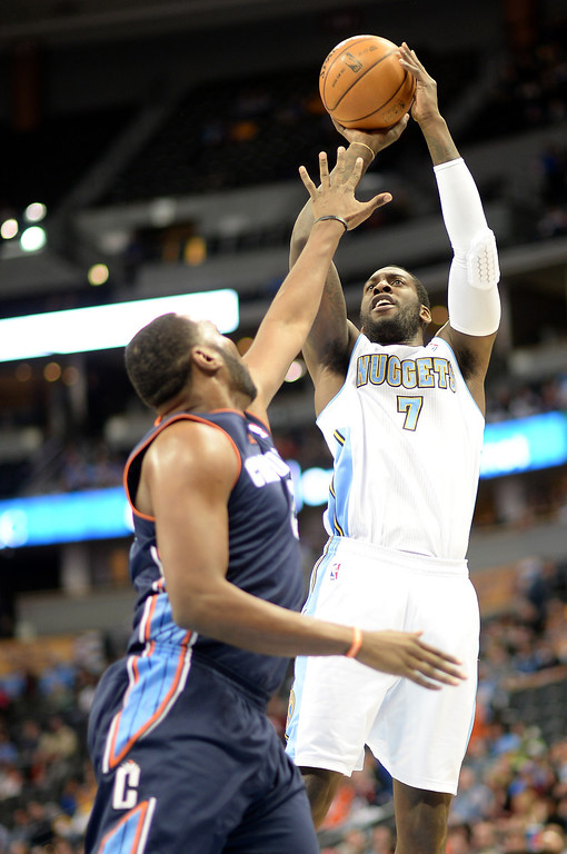 . J.J. Hickson of Denver Nuggets (7) scores over Al Jefferson of Charlotte Bobcats (25) in the first half. (Photo by Hyoung Chang/The Denver Post)