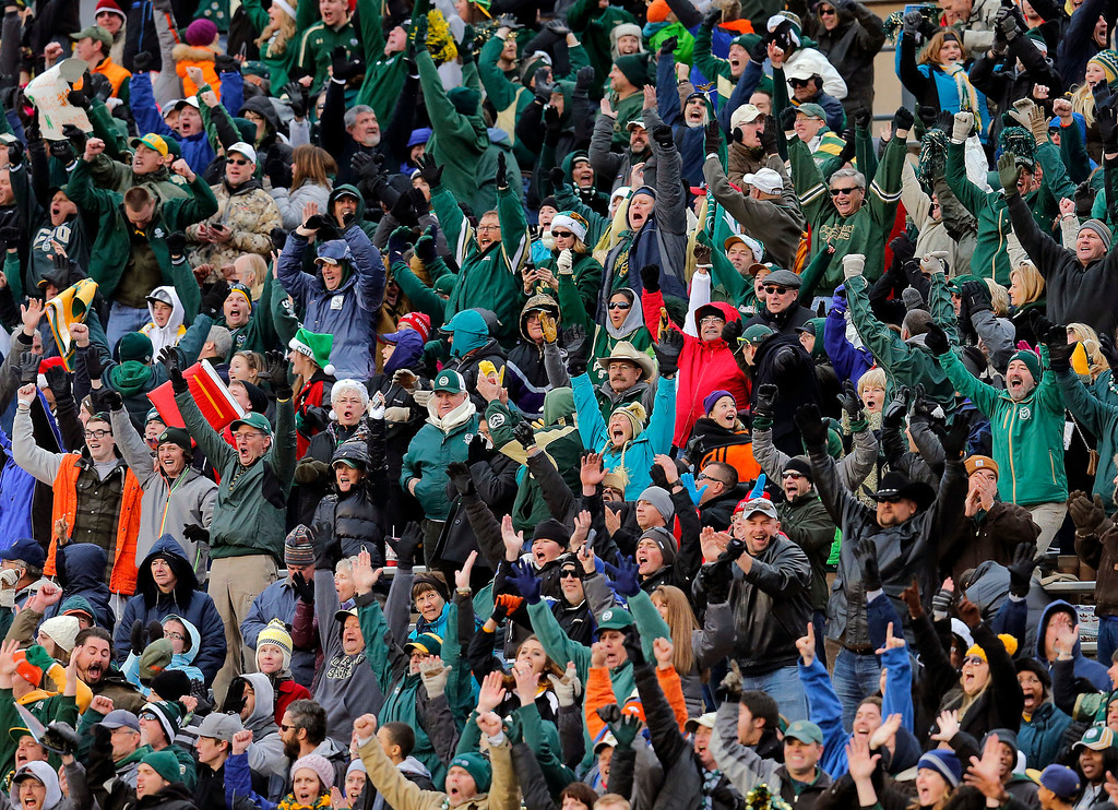 . Colorado State fans celebrate their win after the NCAA New Mexico Bowl college football game against Washington State, Saturday, Dec. 21, 2013, in Albuquerque, N.M. Colorado State won 48-45.(AP Photo/Matt York)
