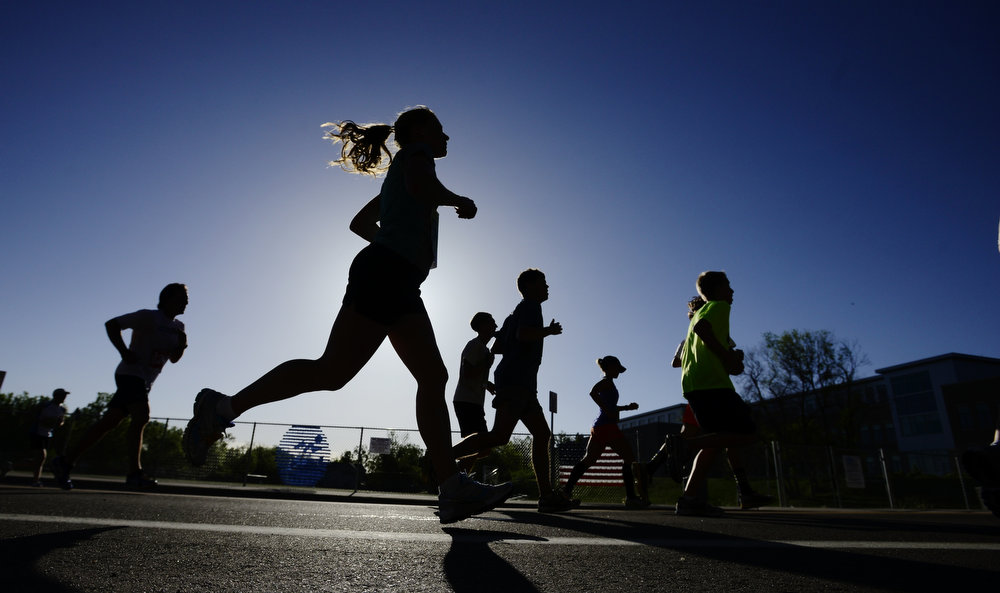 . Runners his the 4 mile mark during the Bolder Boulder in Boulder, Colorado May 27, 2014.  DAILY CAMERA/ Mark Leffingwell