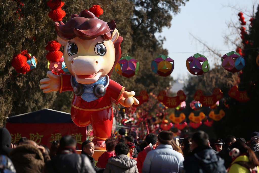 . Tourists walk under a horse sculpture at the Spring Festival Temple Fair for celebrating Chinese Lunar New Year of Horse at the Temple of Earth park on January 30, 2014 in Beijing, China.   (Photo by Feng Li/Getty Images)