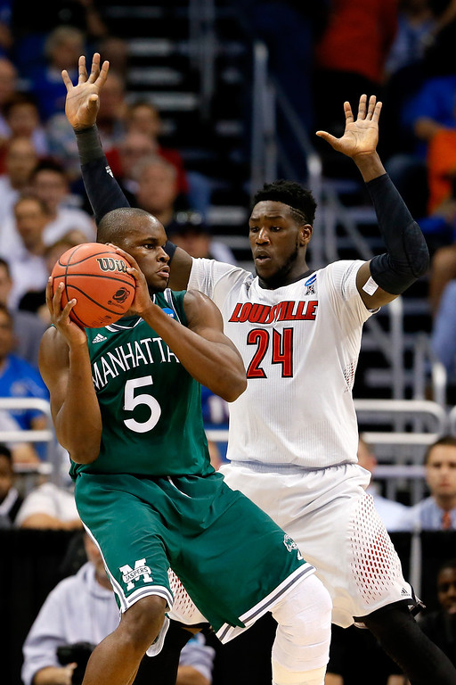 . Montrezl Harrell #24 of the Louisville Cardinals defends Rhamel Brown #5 of the Manhattan Jaspers during the second round of the 2014 NCAA Men\'s Basketball Tournament at Amway Center on March 20, 2014 in Orlando, Florida.  (Photo by Kevin C. Cox/Getty Images)