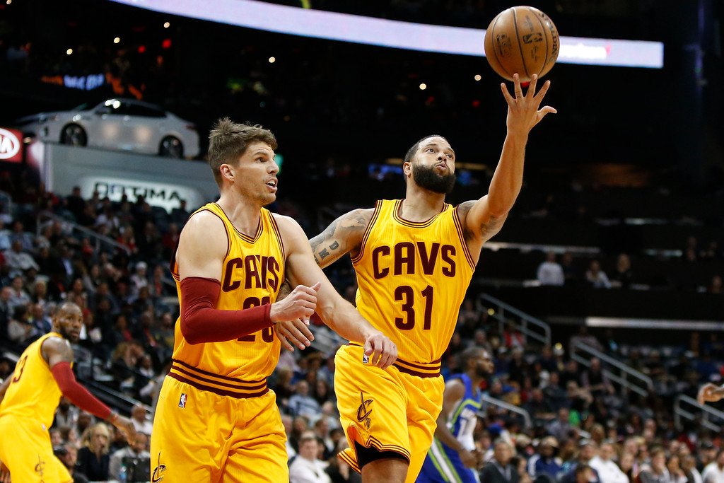 . Cleveland Cavaliers guard Kyle Korver (26) and guard Deron Williams (31) reach for a rebound against the Atlanta Hawks in the first half of an NBA basketball game, Friday, March 3, 2017, in Atlanta. (AP Photo/Brett Davis)
