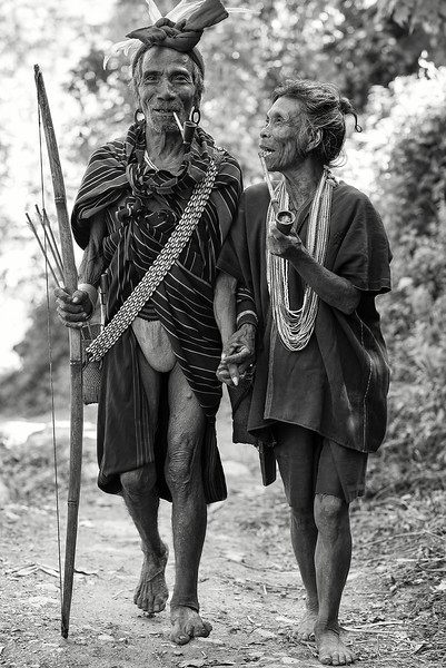 Husband and wife, approximately 70 years old, from the village of Kyardo wearing traditional clothing.  Myanmar, 2017