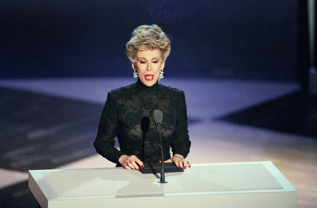 """. A subdued Joan Rivers makes her first television appearance since the August death of her husband in Pasadena, Calif. during the 39th Annual Emmy Award at the Pasadena Civic Auditorium, Sept. 21, 1987. Rivers presented the award for best supporting actor in a comedy series to John Larroquette of NBC\'s \""""Night Court.\"""" (AP Photo/Nick Ut)"""