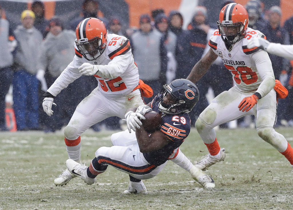 . Chicago Bears running back Tarik Cohen (29) is brought down by Cleveland Browns outside linebacker James Burgess (52) in the second half of an NFL football game in Chicago, Sunday, Dec. 24, 2017. (AP Photo/Charles Rex Arbogast)